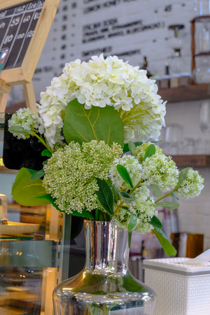 White Flower with Green leaf in The Jar for internal decoration. Look relax , comfortable and peacefulness