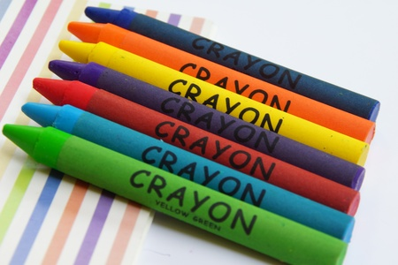Notebook and Colorful Crayon Stock Photo