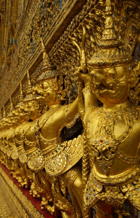 Demon Guardian and Architecture of Grand Palace, Bangkok, Thailand photo