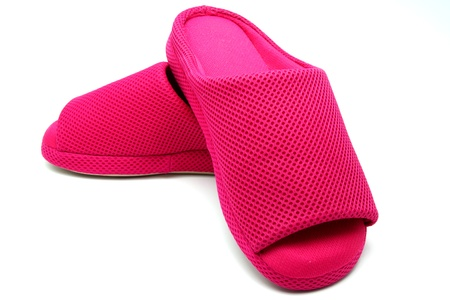 A Pair of Pink Slippers; House Shoes on White Background