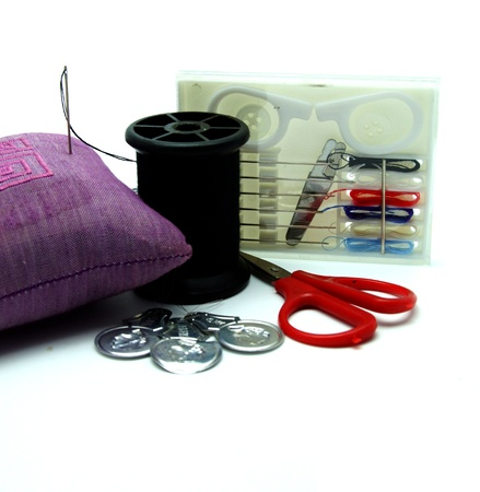 Needle and Thread Sewing Kit on White Background