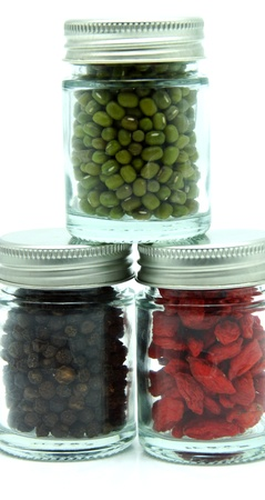 chinese wolfberry: Organic Food - Black pepper, Chinese Wolfberry and Green Mung Bean in Bottle on White Background     Stock Photo