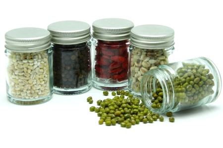 Organic Food; Red Kidney Bean, Black Pepper, Green Mung Bean, Job s Tears and Barley in Bottle on White Background photo