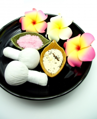 Thai Spa Herbal Massage Set in Tray on White Background photo