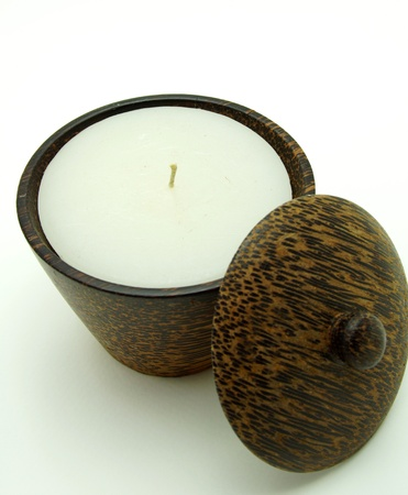 Scented and Aroma Candle in Wooden Candleholder on White Background