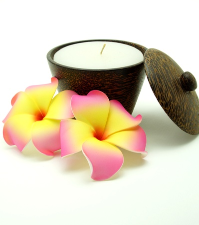 Scented and Aroma Candle in Wooden Candleholder on White Background  photo