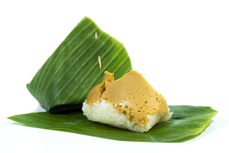 Sweet Sticky Rice with Coconut Custard Wrapped in Banana Leaves
