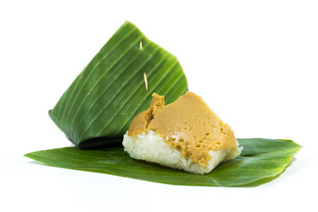 Sweet Sticky Rice with Coconut Custard Wrapped in Banana Leaves photo