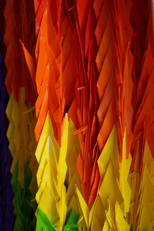 Close up Hanging Colorful Origami Paper Cranes  Stock Photo