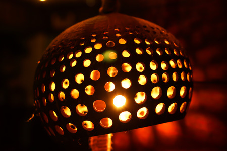 Closeup Carved and Perforated Coconut Lamp Stock Photo