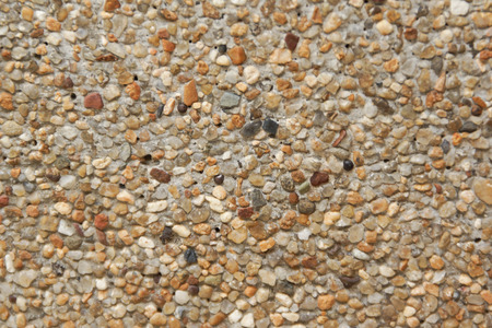 Closeup of Stones and Sand Wall Background