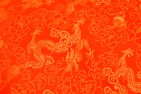 Texture of Red Chinese Silk with Golden Dragons and Flowers Pattern Stock Photo