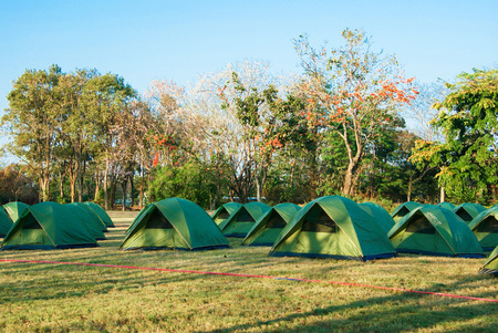 Camping Tents at Campground during Daytime in Forest