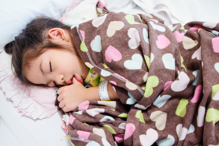 ban aid: Young Baby Girl as Patient Sleeping on Hospital Bed Stock Photo
