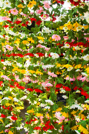 Close up of Colorful Artificial Fabric Flowers photo