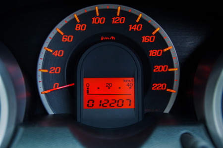mileage: Modern Car Speedometer and Illuminated Dashboard Stock Photo