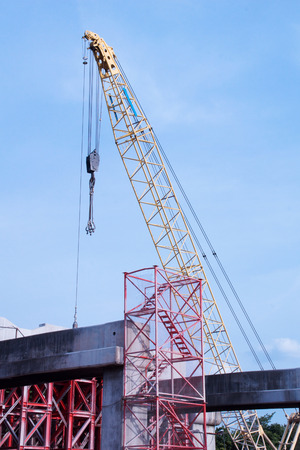 Tower Crane Operating in Construction Site