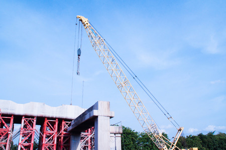 Tower Crane Operating in Construction Site photo