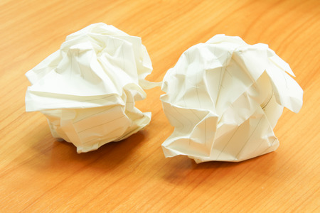 Paper ball - Crumpled Sheet of Writing Paper on Wooden Table Stock Photo