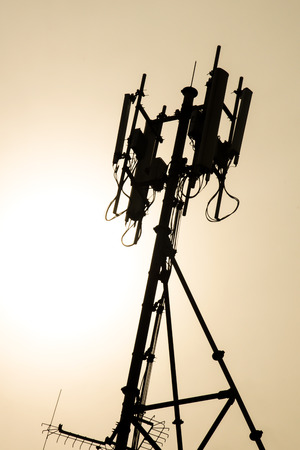 Antenna of Cellular System During Sunset - Silhouette Stock Photo