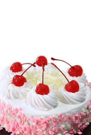 cake decorating: Milk Cake with cherry on the top Stock Photo