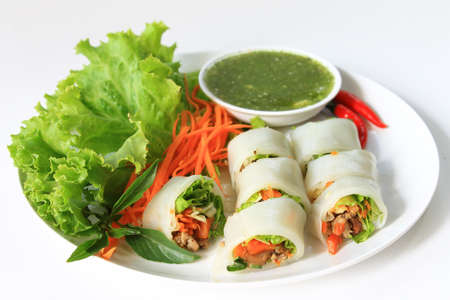 fine dining: Wrapped noodle with vegetables and meat served with sour and spicy sauce