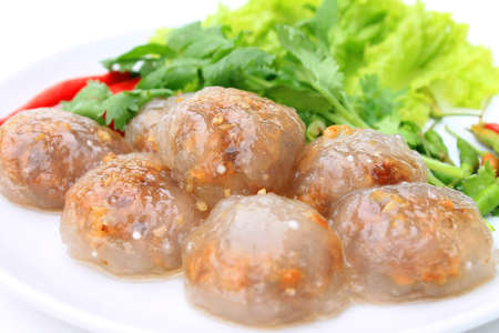 Steamed tapioca balls with peanut and pork filling