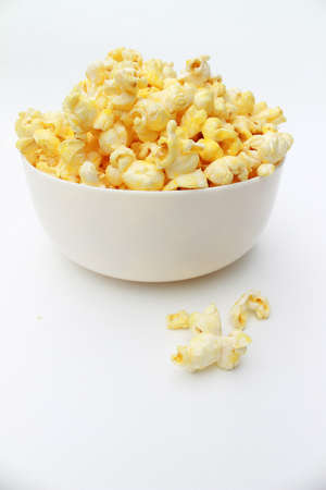 Popcorn with sweet caramel in a white bowl