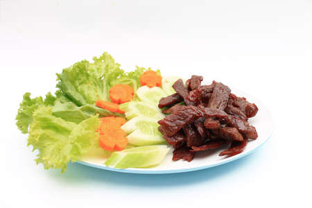 Deep fried marinated beef decorated with vegetables