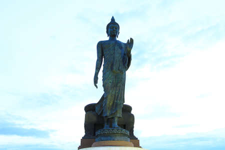 The walking buddha posture at a Buddhist park in the Phutthamonthon district, Nakhon Pathom Province of Thailand