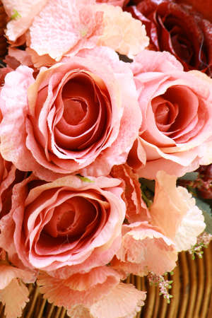 Bouquet of artificial rose flowers for background or greeting card photo