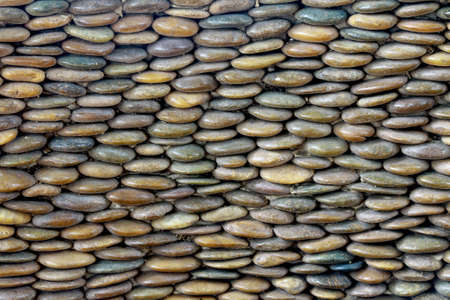 Arranged pebble stones or rocks as background for gardening or decoration