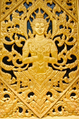 buddha face: The Themple door at  Wang Ma Now Temple , Thailand