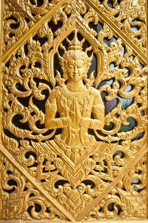 thai buddha: The Themple door at  Wang Ma Now Temple , Thailand