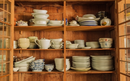 Wooden crockery in the pantry in the kitchen