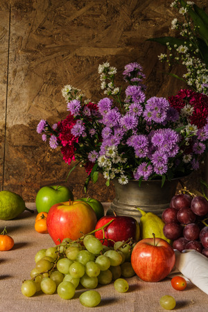 Still life with Fruits were placed together with a vase of flowers beautifully  photo
