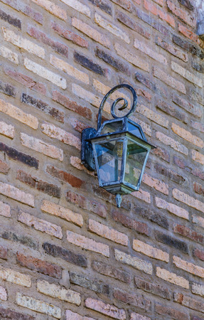 Vintage lantern on a wall in the house photo