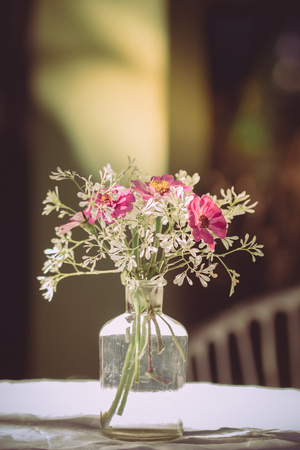 outdoor living: vase of various types of flowers in Vintage Style outdoor Living - as part of the home decoration Stock Photo
