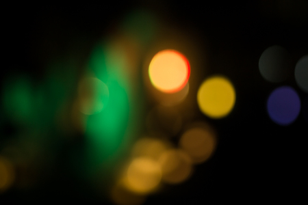 Abstract circular bokeh lighting in the night can be used for background and text input Stock Photo