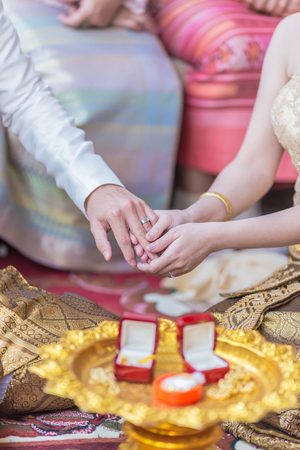 He Put the Wedding Ring on Her in the wedding ceremony In Asia, Thailand