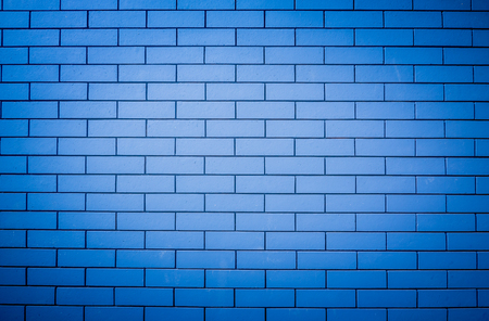 aging: The image of a blue brick wall for use as a background and text. Stock Photo