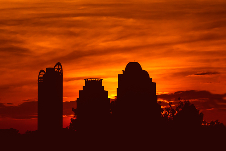 Photos shadow of buildings background with urban landscape (buildings and sunset)