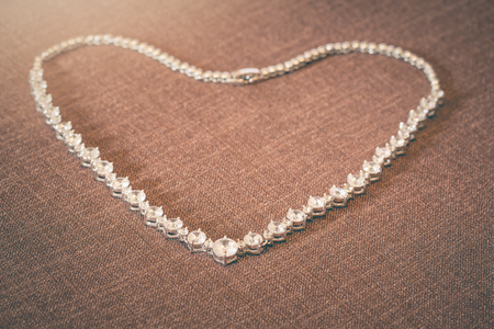 Pendent jewelry made of silver and diamond heart-shaped for women who are prepared to be a bride.