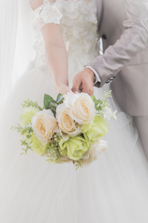 Bride and groom embracing each other along the river as a symbol of marriage.
