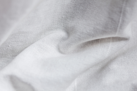 suitable: close up of white linen textured cloth background is suitable for use paste text and illustrations.