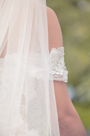 Back bridal veils off the set with a beautiful symbol of the marriage.