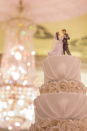 Vintage Wedding Cake  with bokeh background, filtered image a symbol of love