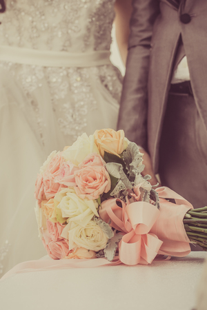 Bouquet and the couple who are married, vintage tone.