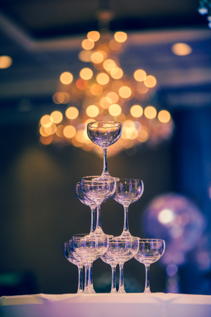 A glass of champagne at a party celebrating the wedding with beautiful bokeh background. Standard-Bild