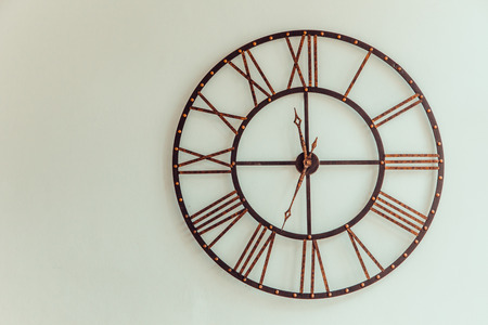 numeros romanos: Old Clock made of wrought iron wall to use as decoration. Foto de archivo